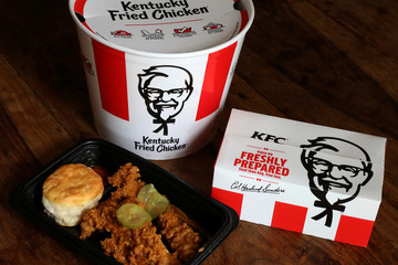Kentucky Fried Chicken (KFC) tenders, a bucket and box of chicken are seen in this picture illustration