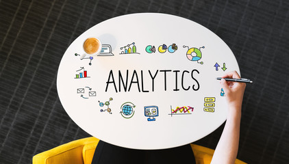 Analytics text on a white table