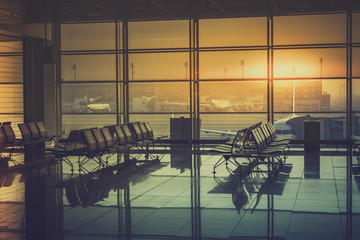Fotorolgordijn Luchthaven Silhouette of an empty airport terminal during sunrise. Travel Concept. Vintage colors