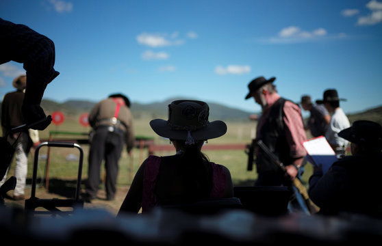 Lilly Brown, 14, who has adopted the character 'Lethal Lilly', is silhouetted at the Women of the West shooting competition at the Namoi Pistol Club in Gunnedah in rural New South Wales