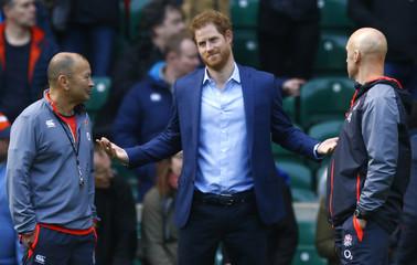 Britain's Prince Harry with England head coach Eddie Jones during training