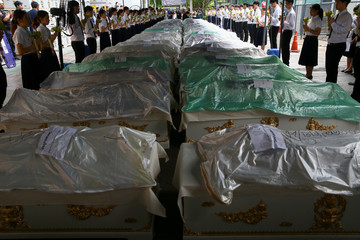 Medical students take part in a religious ceremony to pay respects to cadavers used during their medical studies before the bodies are removed from Chulalongkorn Hospital in Bangkok