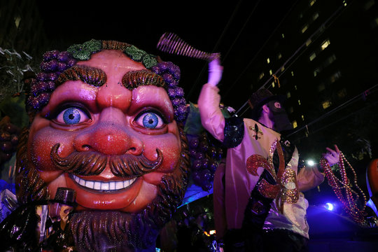 A float rider throws beads at the Bacchus parade during Mardi Gras in New Orleans, Louisiana