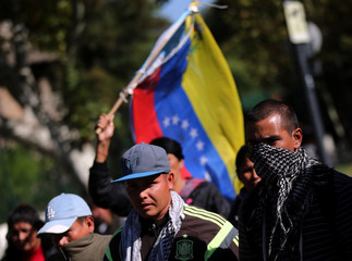 Demonstrators attend a protest against U.S. President Donald Trump's foreign policy towards Syria and Venezuela outside U.S embassy in Buenos Aires