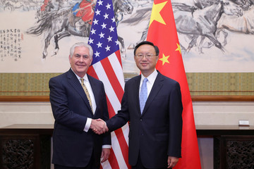 Chinese State Councilor Yang Jiechi shakes hands with U.S. Secretary of State Rex Tillerson before their meeting at Diaoyutai State Guesthouse in Beijing