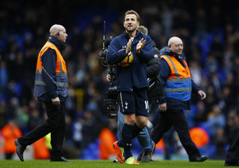 Tottenham's Harry Kane applauds the fans at the end of the match whilst holding the match ball after completing a hat trick