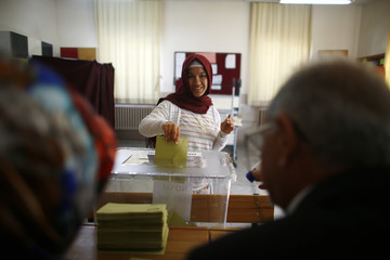 A woman casts her ballot at a polling station during a referendum Aegean port city of Izmir