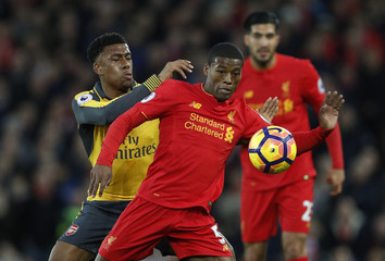 Liverpool's Georginio Wijnaldum in action with Arsenal's Alex Iwobi