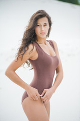 Fitness beautiful slim girl with brown hair posing