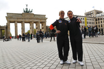 Thiele-Eich and Baumann pose for a picture after being announced as Germany's first female astronauts during a media event at the Brandenburg Gate in Berlin