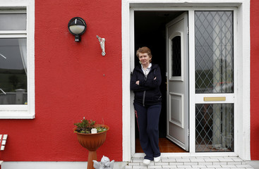 Historian Catherine Corless poses for a photograph at her home, in Tuam