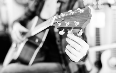 fingers holding guitar pegs
