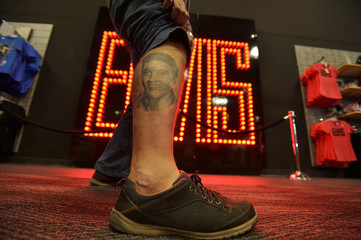 "Paul Winter of the United Kingdom, shows off his tattoo of Elvis Presley during the grand opening of the new ""Elvis Presley's Memphis"", a $45 million, state of the art entertainment and museum complex, in Memphis"