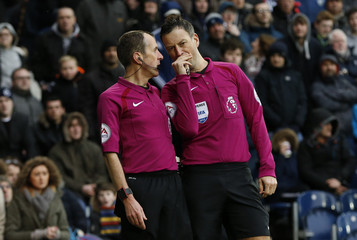 Referee Mark Clattenburg and the assistant referee