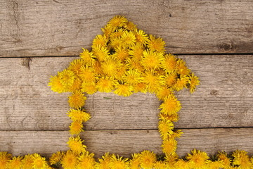 Composition with yellow flowers, house cottage, children's work