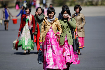 Women wear traditional clothes as North Korea prepares to mark Saturday's 105th anniversary of the birth of Kim Il-sung, North Korea's founding father and grandfather of the current ruler, in central Pyongyang