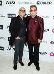 Elton John and Bernie Taupin, pose at RED Studios Hollywood