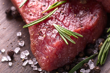 Beef steak with rosemary , salt and pepper.