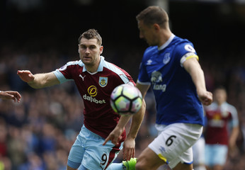 Burnley's Sam Vokes in action with Everton's Phil Jagielka