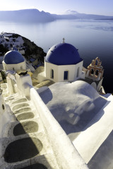 The blue dome is a typical cult building of cyclades islands, Oia village, Santorini island, Greece