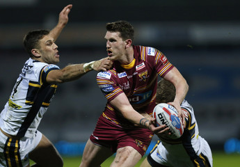 Lee Gaskell of Huddersfield Giants and Joel Moon of Leeds Rhinos (L) in action