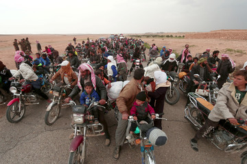 People fleeing from areas surrounding Euphrates River dam, east of Raqqa city, ride their motorcycles towards Syrian Democratic Forces (SDF) controlled areas, Syria