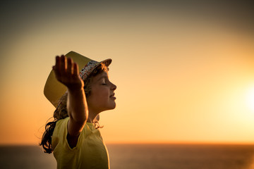 Silhouette of child at the beach