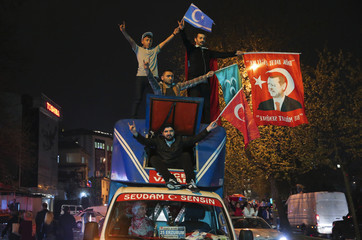 Supporters of Turkish President Tayyip Erdogan celebrate in Istanbul