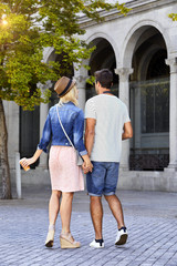 Walking couple in city, holding hands