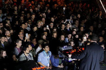 People attend a performance by Sohn at the Mohawk bar at the South by Southwest (SXSW) Music Film Interactive Festival 2017 in Austin