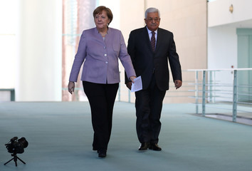German Chancellor Merkel and Palestinian President Abbas arrive for a statement in Berlin