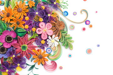 Beautiful flowers made in quilling art