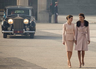 Spain's Queen Letizia and Argentina's first lady Awada walk during the welcoming ceremony at Royal Palace in Madrid