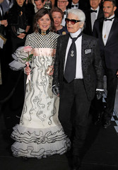 Princess Caroline of Hanover poses with Karl Lagerfeld as they arrive at the Monte Carlo Sporting for the Bal de la Rose in Monte Carlo