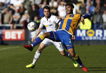 Bolton Wanderers' Andrew Taylor (L) in action with Shrewsbury Town's Tyler Roberts