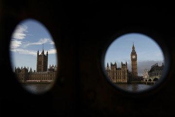 The Houses of Parliament are seen through a broken telescope in London