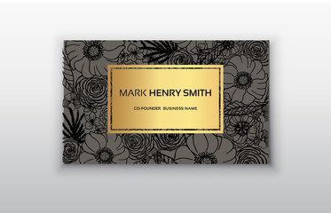 Vector gold business card with flowers.