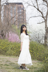 Spring portrait of a beautiful Asian girl