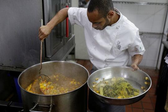 Ronald Carpio, a chef at La Casa Bistro restaurant, prepares soup to be donated to the J.M. de los Rios Children Hospital, in Caracas