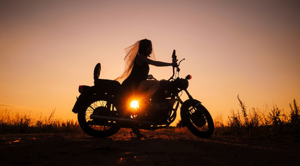 Silhouette of girl on a motorcycle,