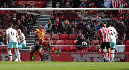 West Ham United's Darren Randolph in action with Sunderland's Victor Anichebe as Sunderland's Wahbi Khazri (not pictured) scores their first goal