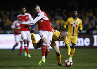 Arsenal's Lucas Perez in action with Sutton United's Adam May