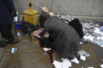 A woman lies injured after a shotting incident on Westminster Bridge in London