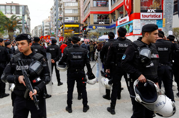 Riot police stand guard during an anti-government protest in Kadikoy district of Istanbul