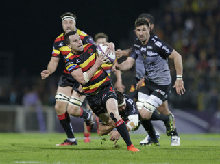 Tom Marshall of Gloucester tackled by Pierre Aguillon of La Rochelle