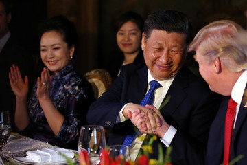 Chinese President Xi Jinping shakes hands with U.S. President Donald Trump in West Palm Beach