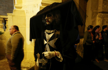 A reveller takes part in a spontaneous carnival characterised by improvisation, satire and the macabre, in the village of Ghaxaq