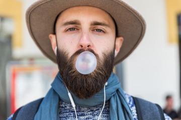 Stylish man chewing a gum