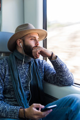 Man listening music in train