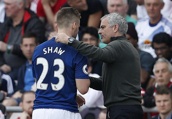 Manchester United's Luke Shaw is congratulated by manager Jose Mourinho as he is substituted